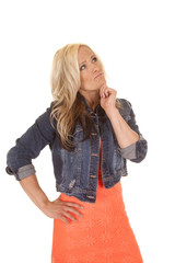 woman orange dress denim jacket thinking