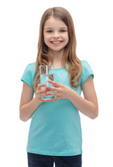 smiling little girl with glass of water