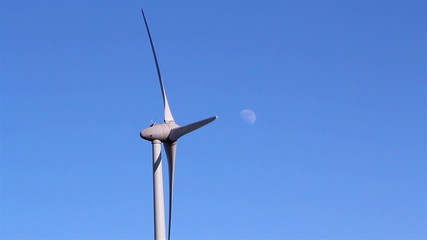 The windmills propeller is turning