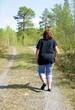 Overweight woman walking on a dirt road