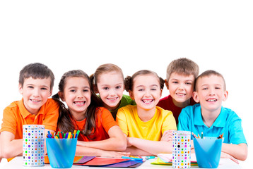 Group of children sitting at a table.