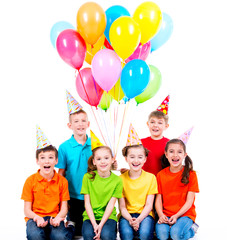 Happy boys and girls with colored balloons.