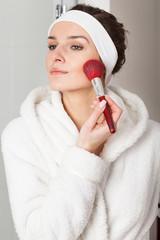 Woman using face powder