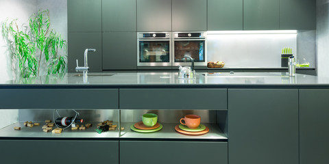 frontal view of modern anthracite kitchen with decoration