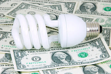 Saving energy bulb on money.