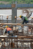 Two Construction Workers Installing Formwork poster