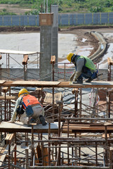 Two Construction Workers Installing Formwork