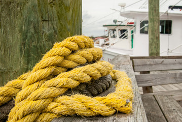 Thick Yellow Rope Wrapped Around Post on Pier