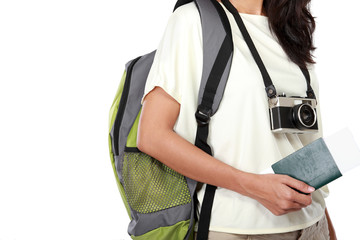 woman body with camera and passport ready to go on vacation