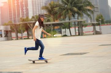 skateboarding woman speeding in city
