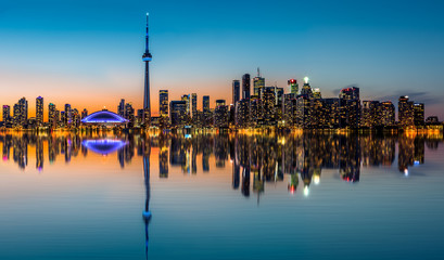 Toronto skyline at dusk reflected in the Inner Harbour Bay