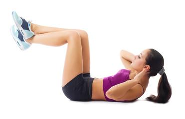 Sporty woman doing gymnastic exercises