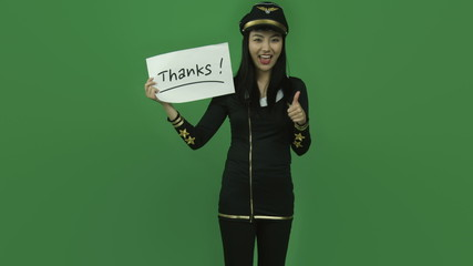 Asian air hostess isolated greenscreen green background grateful