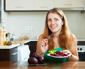 ordinary girl eating boiled beets
