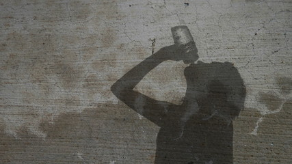Silhouette Woman Drinking from Waterbottle