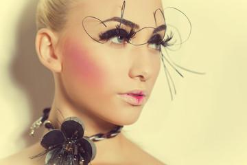 Gorgeous model with perfect art make up and long false eyelashes