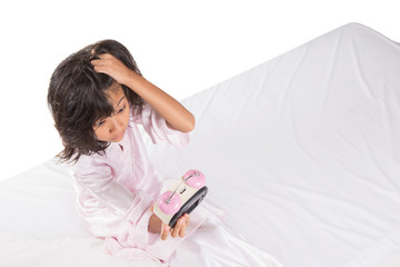 Concept image of young girl overslept checking time with a clock