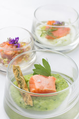 Three glasses filled with appetizers of lachs