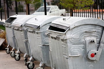 Trash cans in a row outdoors