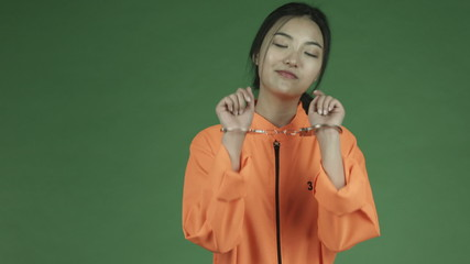 young asian adult woman prisoner isolated on green-screen
