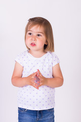 Young girl pointing both index fingers explaining concept