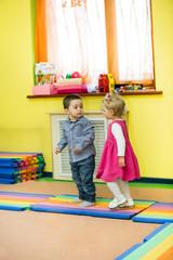 Two kids in Montessori preschool Class.