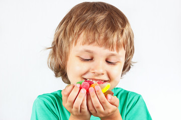 Child with sweets and colored jelly candies
