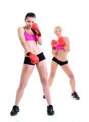 sport training of two boxing young woman, studio