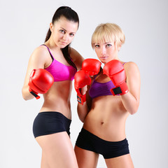 sport training of two boxing young woman