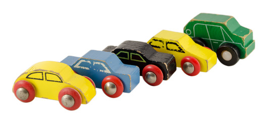 wood miniature colorful car toy isolated on white