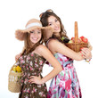 two young beautiful cheerful friends women holding baskets with