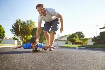 father son skateboard