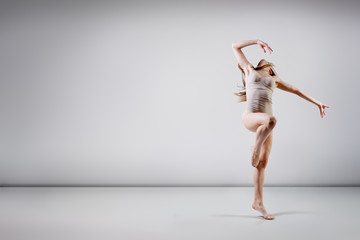 young beautiful dancer teen girl dancing and jumping, studio ser