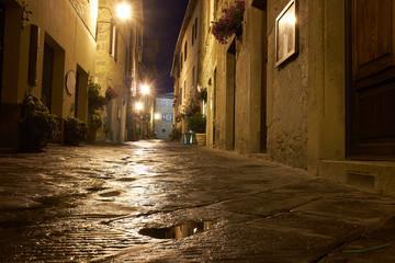 Illuminated Street of Pienza after rain at Night, Italy