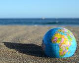 Fototapety Globe Earth on the Beach