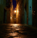 Illuminated Street of Pienza after rain at Night, Italy - 65624395