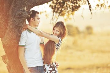 Happy teen couple embracing.
