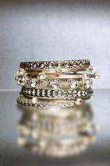 Several shining bracelets on blue background.
