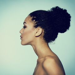 Beauty portrait of young mulatto fresh fashion woman in profile,