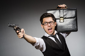 Man with gun and briefcase