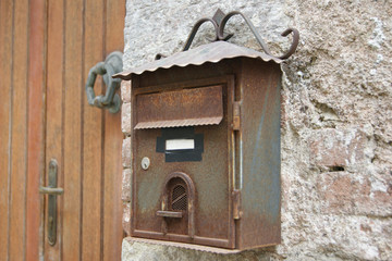 Retro metal mailbox in the form of home