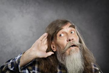Senior listening, old man hold hand near ear. Deaf  loss rumor