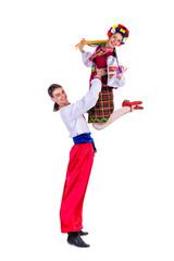 beautiful dancing couple in ukrainian polish national