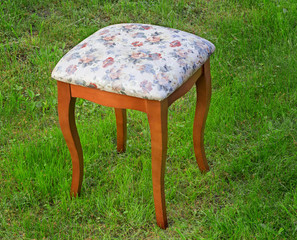 Convenient stool with the seat upholstered with a gobelin.