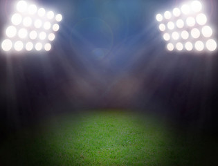 Green soccer field, bright spotlights