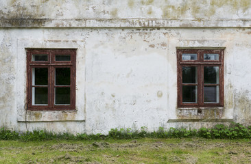 The old plastered wall with a windows