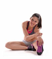 Joven mujer estirando musculos,ejertando gimnasia.