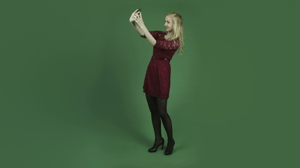 caucasian woman in red dress isolated on chroma green screen