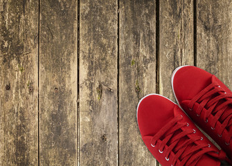 red sneakers on wooden deck