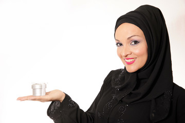 Arabic young woman,dressed in abaya,holding a present,